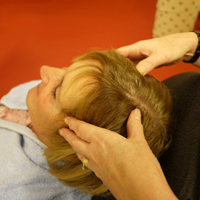 Photograph of someone having a head massage