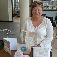 Photograph of Val with some of her cards