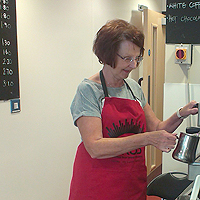 Photograph of volunteer working in the centre cafe