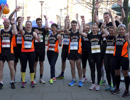 Photograph of previous SRSB runners in Sheffield Peace Gardens