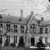 Black and white photo of the exterior of the old school on Manchester Road