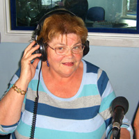 Photograph of Trina presenting radio show