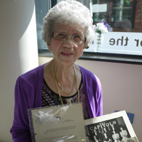 Photograph of Joyce at SRSB with her letter and photograph of the CAPITOLS