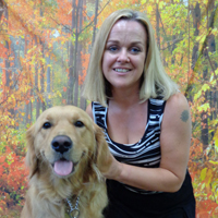Photograph of Sarah and her guide dog