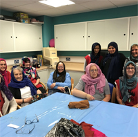 Photograph of SRSB client, volunteers and staff wearing headscarves