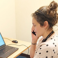 Photo of SRSB staff member on the telephone