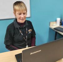 Photo of Liz at a computer