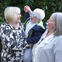 Photograph of one of SRSBs Little Sparklers with his mum and grandma