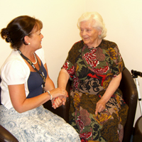 Photograph of SRSB client chatting to Befriending Volunteer