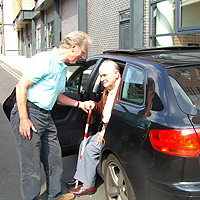 Photograph of volunteer driver helping SRSB client out of a car