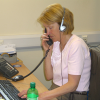 Photograph of Tele-Contact volunteer making a telephone call