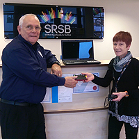 Photograph of presentation of equipment at SRSB