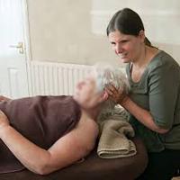 Photo of Sarah doing a treatment
