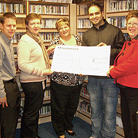 Photograph of cheque presentation