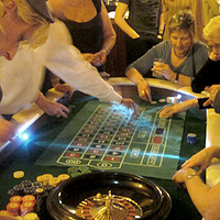 Photograph of people playing roulette at a corporate event