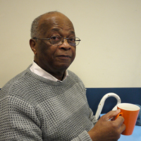 Photograph of one of SRSBs clients drinking a cup of tea